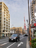 A luxury car running on street in Tokyo, Japan Royalty Free Stock Image