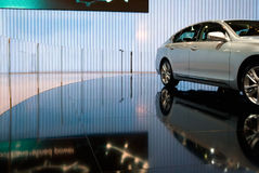 Luxury car in a showroom. Low angle shot of a luxury car inside an elegant showroom Royalty Free Stock Photography