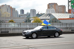 Luxury  car with Ukrainian flag Royalty Free Stock Images