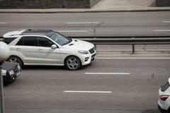 Luxury car white Mercedes  Benz GL speeding on empty highway Royalty Free Stock Image