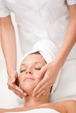 Luxury care - woman at face massage Royalty Free Stock Photo
