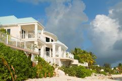 Luxury Caribbean Beachfront Home stock images