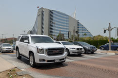 Luxury Cars in front of Jumairah Hotel, Dubai City, United Arab Emirates on 6th May 2015. Luxury Vehicles in Dubai Traffic Stock Photos