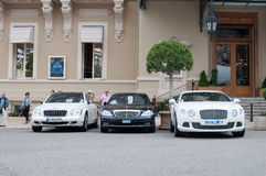 Luxury cars outside Monte Carlo Casino Royalty Free Stock Photo