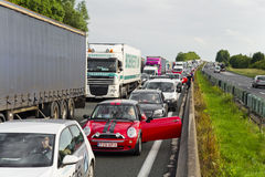 Cars and trucks queuing up on the high way during rush hour traffic jamed Stock Photo