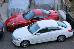 Luxury Cars Parked in a Parking Lot Royalty Free Stock Images