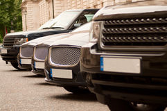 Luxury cars in a row. As seen from a perspective Stock Photo
