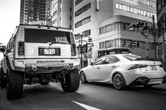 Luxury cars on the street of Ikebukuro district of Tokyo, Japan Royalty Free Stock Images