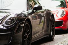 Luxury cars. Two luxury cars, black and red Stock Image