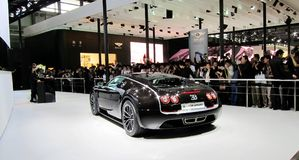 Luxury cars and visitors. 2011 Shanghai International Automobile Industry Exhibition Royalty Free Stock Photography