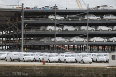 Luxury cars wrapped for protection await export at docks Royalty Free Stock Images