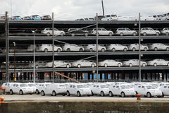 Luxury cars wrapped for protection await export at docks Stock Photography