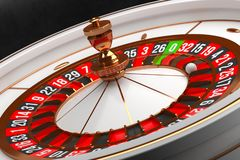 Luxury Casino roulette wheel on black background. Casino theme. Close-up white casino roulette with a ball on zero stock photography
