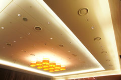 Luxury ceiling. The ceiling of assembly room with luxury decorative lights royalty free stock photography