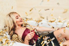 Luxury celebration blonde girl bathtub confetti stock photography