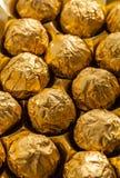 Luxury chocolate balls in box. Chocolate balls in just opened box Royalty Free Stock Photo
