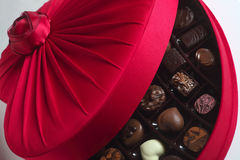 Luxury chocolate box open. An open red heart-shaped box of luxury chocolates Stock Image
