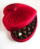 Luxury chocolate box open. An opened red heart-shaped box of luxury chocolates Stock Image