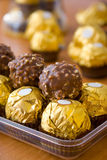 Luxury chocolate candies. Delicious luxury candies in gold wrapping Royalty Free Stock Image