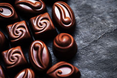 Luxury Chocolate over black background. Chocolate Candy, Cocoa. Royalty Free Stock Image