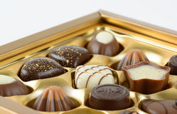 Luxury chocolates. Luxury chocolate assortment in a gold box Stock Photos