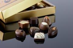 Luxury chocolates. Luxury chocolate assortment next to a gold box Stock Photography