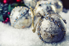 Luxury Christmas ball in the snow and snowy abstract scenes. Christmas ball on glitter background. Royalty Free Stock Photos