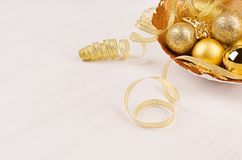 Luxury christmas decorations of gold on white wood board, blur. Stock Photos