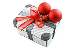 Luxury christmas gift box. Gift box with stripes and xmas balls isolated over white Stock Image