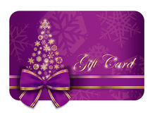 Luxury Christmas gift card with purple ribbon  Stock Photos