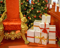 Luxury christmas gifts near Santa Throne Royalty Free Stock Photos