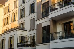 Luxury city flats with balcony and window blinds stock photos
