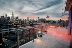 Luxury city rooftop balcony with chilling area in New York City Manhattan midtown. Elite real estate concept. Luxury city rooftop balcony with chilling area in stock photos
