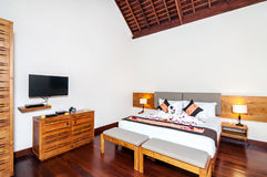 Luxury and Classic Bedroom Villa Hotel. Beautiful interior and Bedroom villa and Hotel in Bali style property, Indonesia with wooden style furniture stock photos