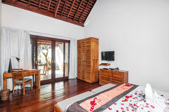 Luxury and Classic Bedroom Villa Hotel. Beautiful interior and Bedroom villa and Hotel in Bali style property, Indonesia with wooden style furniture stock photo