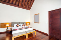 Luxury and Classic Bedroom Villa Hotel. Beautiful interior and Bedroom villa and Hotel in Bali style property, Indonesia with wooden style furniture royalty free stock images