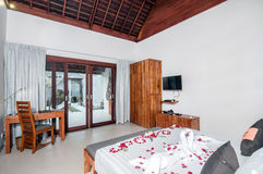 Luxury and Classic Bedroom Villa Hotel. Beautiful interior and Bedroom villa and Hotel in Bali style property, Indonesia with wooden style furniture stock photography