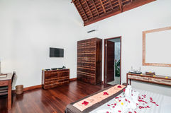 Luxury and Classic Bedroom Villa Hotel. Beautiful interior and Bedroom villa and Hotel in Bali style property, Indonesia with wooden style furniture royalty free stock photography
