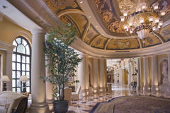 Luxury classic corridor and ornate luster. Luxury classic colonnade corridor issued from hall with ornate luster Stock Photography