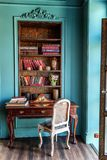Classic Interior of home library. Luxury classic interior of home library. Sitting room with bookshelf, books, table and chair. Clean and modern decoration with royalty free stock photography