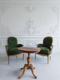 Luxury clean bright white interior with a old antique vintage green chairs over wall design bas-relief stucco mouldings roccoco el Stock Photography
