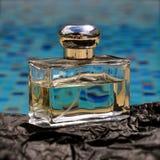 Luxury clear glass perfume bottle against a blue stock photos