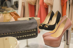 Luxury clothing store. Shoes, purse and clothing Stock Photo