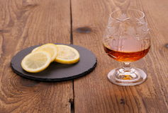 Luxury Cognac in decorated crystal glass and lemon Royalty Free Stock Images