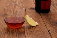 Luxury Cognac in decorative glass on wood, lemon Royalty Free Stock Photos