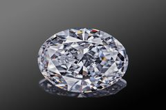 Luxury colorless transparent sparkling gemstone shape oval cut diamond isolated on black background royalty free stock images
