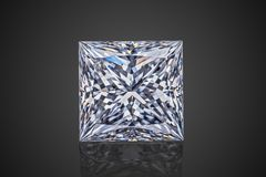 Luxury colorless transparent sparkling gemstone square shape princess cut diamond isolated on black background royalty free stock photos