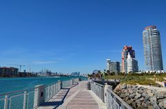 Luxury Condo Towers Overlooking a Fishing Pier and the Atlantic Ocean Royalty Free Stock Images