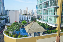 Luxury Condominium with Beautiful Swimming Pool. In a developing country surrounded by other high rise building royalty free stock image