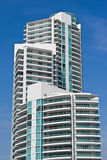 Luxury Condominium High Rise. Modern, luxury condominium high rise located in Miami Beach, Florida. Taken from low perspective upward. Against a blue, cloudless stock image
